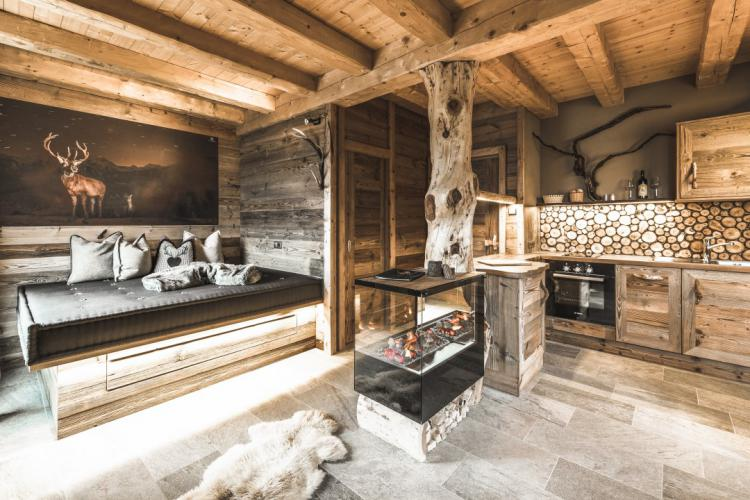Antique wood and a fireplace provide an very warm atmosphere