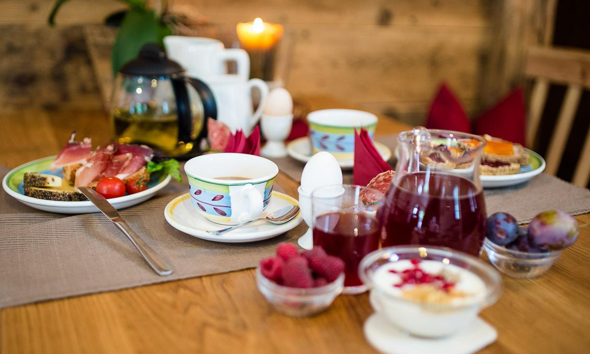 Breakfast table with farm-fresh products, at Chalet Resort Zu Kirchwies