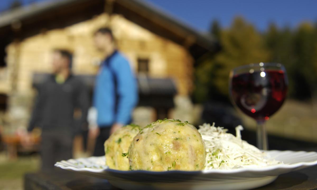 South Tyrolean-style bacon dumpling with cabbage salad and red wine